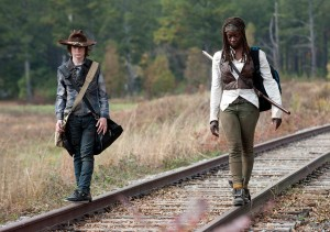 Carl Grimes (Chandler Riggs) and Michonne (Danai Gurira) - The Walking Dead _ Season 4, Episode 15 - Photo Credit: Gene Page/AMC